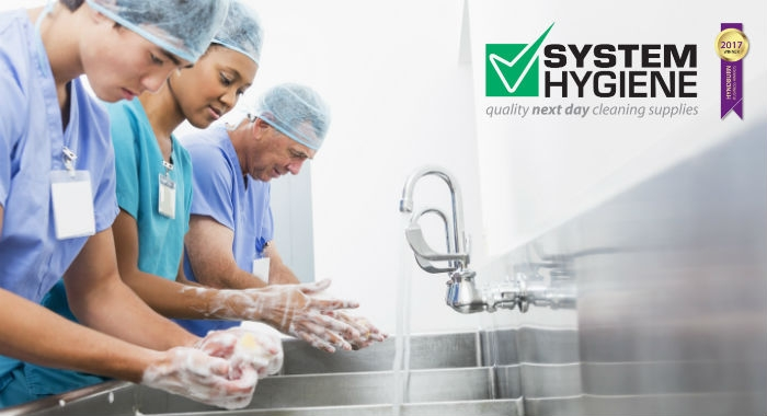 Image of medical staff scrubbing up for good hand hygiene nhs