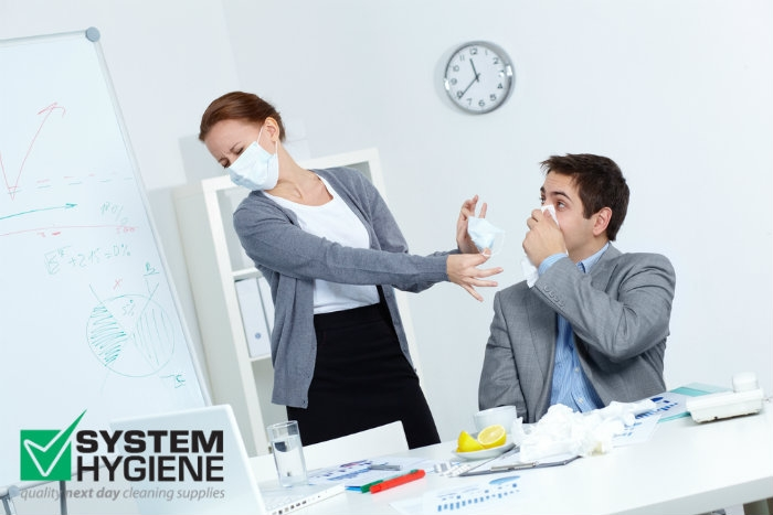 Photograph of office workers batting autumn flu and virus season